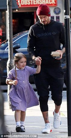Daddy cool: David Beckham seen enjoying a chat with his only daughter as he held her hand ...