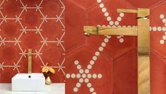 {The Staging Scoop}: Orange tile, brass faucet