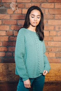 Slouchy ladies cabled sweater with shaped hem and raglan sleeves - download the pattern from LoveKnitting!