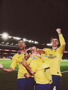 Giroud, Koscielny, and Mertesacker celebrate Flamini's goal :)