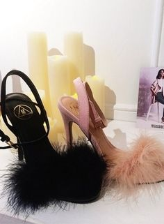 Unleash your inner Carrie Bradshaw in these to-die-for marabou feather high heels. OMG.