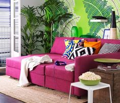 I'm seriously considering this couch for the new place!  Pink..why the heck not!