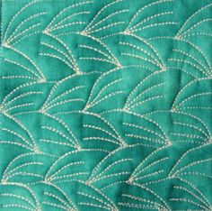 Free Motion Quilting Project by Leah Day.  Over 200 different patterns w/ vidoes to show how to do them.