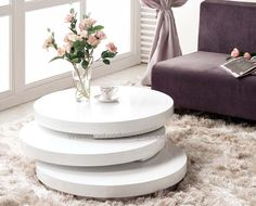 Artisco Round Coffee Table Only $599 The Artisco Round Coffee Table is an art itself and will surely blend in with todays modern art living. Feature very unique design in high white gloss polyurethane finish with three layers of circular top, middle and bottom piece, all can be rotated according to your tastes. Finally, adding some slices of art into your living room is simple with this modern day art coffee table. #coffeetablesforsale #retrodesigns