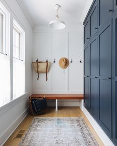 Home Decoration Livingroom I had already planned dark cabinets in our mudroom but this just sealed the deal. Küchen Design, House Design, Foyer Design, Chair Design, Blue Accent Walls, Mudroom Laundry Room, Laundry Shelves, Laundry Sorter, Decoration Chic