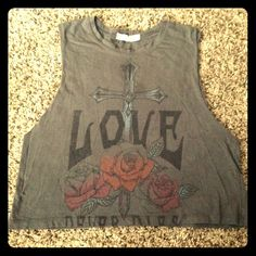 Forever 21 Crop Muscle Tee Says love with a cross and flowers. Cute design. Does have a small hole in the back shown in pics. Forever 21 Tops Crop Tops