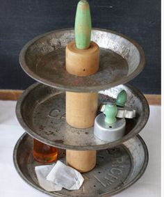 Make your own tiered organizer | Craft Storage Ideas - love this idea! vintage pie tins and a rolling pin!