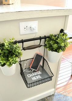 DIY a cell phone charging station using a towel rack and basket