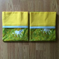 Unicorn print pillowcases by Palindrome Dry Goods. 100% cotton, machine washable, standard sized.