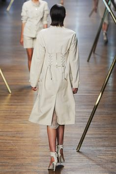 The corset detailing on this trench. Jason Wu. #jasonwu #nyfw #spring2014
