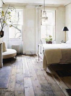 original wooden floorboards and pretty chandeliers