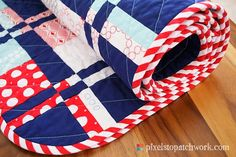 From Pixels to Patchwork.  This is a nice site and a cool quilt with a SUPER back-side design.