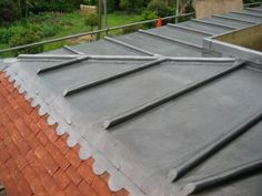 Leadwork with clay tiles. www.tmroofing.com