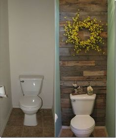 DIY Recycled Wooden Pallet Wall with cheery yellow willow wreath for ensuite toilet room.