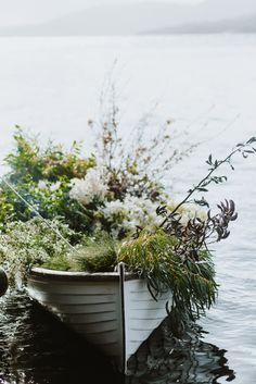 Photo by Luisa Brimble © satellite island wooden boat full of flowers by jardine hansen