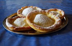 """German Fasnacht Recipe Ausgezogene or """"Knieküchle"""" (knee pastries) are a different form of Krapfen or pancakes; it is a traditional and local recipe."""