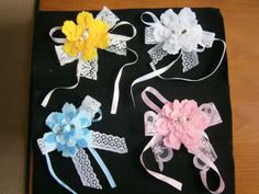 These are wrist corsages for weddings, but can be for Proms, Flower Girls, Bridesmaids, etc. They are made from Felt with, lace, bead and rose trim. The ribbon can be tied round the wrist. Can also be made as combs and brooches. £6.50 each