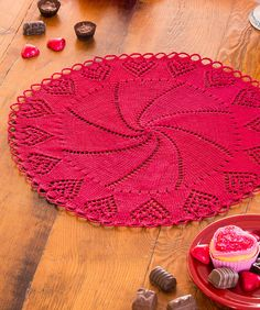 Free Knitting Pattern for Valentine Heart Doily - The elegant spiral center of this doily is surrounded by a border of lacy eyelet hearts and finished with delicate chain scallops at the edge. Designed by Nazanin S. Fard for Red Heart
