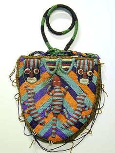 Yoruba Bag ~ Used to carry divination objects and tools, the bags are worn in public ceremonies by Ifa priestesses and used and displayed in their homes. Beads were signs of wealth and status. The beaded front lifts up to reveal a pouch on the back panel.