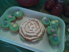 Easter flower cake with cupcakes Eggs are candy Whoppers