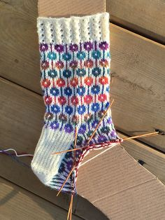 I saw this motif on a socks and a pair of mitts, so I charted out my own version. Switch to color pattern and work 10 repe. Fair Isle Knitting, Knitting Socks, Knitting Needles, Knit Socks, Mitten Gloves, Mittens, Sock Crafts, Lang Yarns, Boot Cuffs