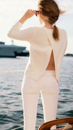 classic white sweater with an open back and white jeans