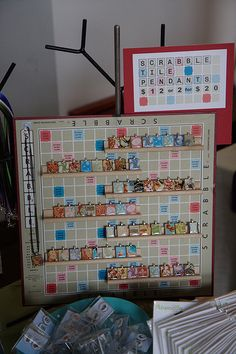 Scrabble Pendants and display.  BRILLIANT!  I have a few boards left from garage sale purchases to get more tiles.