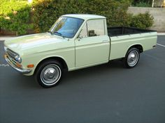 1972 Datsun Pickup.  Mine was like this, only in tan, and kind of beat up.  Had it for a short time in the early 1980's.  It was actually not my vehicle, as I couldn't drive it (it was a stick), but it was a little bit fun (though kind of scary due to its small size).  I'll never forget the day when my son, age 3, was stuck in it, his seatbelt had to be cut, because it would not unlatch.  Not long after that, we got rid of this little stinker.