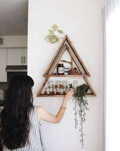 Peaks on Peaks on Peaks. This was my original idea for the implied mountain shelves and am so very happy to offer it now! There are two equilateral triangles stacked one on top of another to create a nice shadow box. Finished in Mahogany stain and easy to hang, this will add the