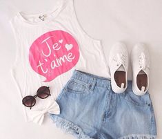 Gorgeous denim shorts with top white cute tee and white soft shoes and black goggles the best summer outfits