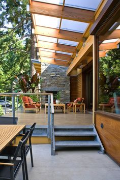 great sunshade constructed of solid materials (translucent plane over wood structure) to filter light and use the seating area even when its raining. contemporary patio by Darwin Webb Landscape Architects, P.S.