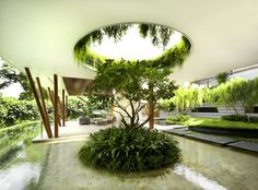 What do you get when you combine a curved roof, an interior courtyard, a rooftop garden, and an outdoor entertaining areas that rival those of most interiors? You get this...