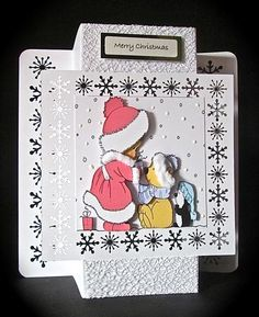 Christmas girl mini kit on Craftsuprint designed by Cynthia Berridge - made by Cynthia Massey - Printed onto Crafty Bobs matte paper, trimmed away the border and mounted onto a pop-out card with a front snowflake border and a back snowflake border, decoupaged with foam pads, added fur, liquid snow and my own silver foiled sentiment, such a cute design. - Now available for download!