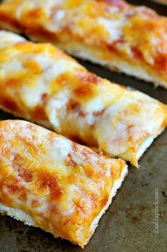 Cheesy Pizza Sticks | Homemade pizza dough and sauce with piles of great cheeses! So good!©addapinch.com