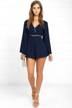 Everything becomes possible the moment you slip into the Wyldr Hope So Navy Blue Romper! Sleek woven poly forms a darted bodice with a…