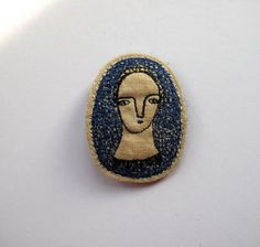 Simply  a portrait brooch with indigo  embroidery by cathycullis, £22.00