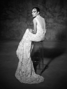 PELAYO, Yolan Cris. The turtleneck bridal trend is featured in this haute couture lace wedding dress, nice romantic U-shaped neckline and mermaid silhouette. Romantic and a little bohemian.