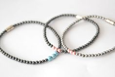 ANKLE MAGNETIC BRACELETS.  4 mm black round with pink or blue accent beads. and 4mm silver round with pink accent beads by AussemBoutique on Etsy#magneticjewelry#hematitejewelry#anklebracelets#blackbeaded#silverplatedbeads#pink#blue#therapeutichealth