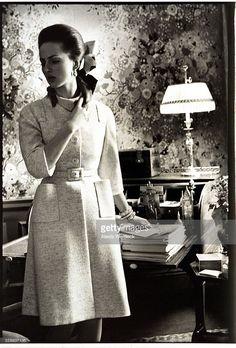Baroness Wiltraud von Furstenberg wearing a soft belted coat by Mainbocher; Vogue, 1968.