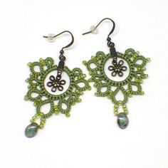 """Green lace earrings with green drop bead and bronze flower centers. 2"""" dangle earring. Bronze fishhook ear wires. Greenery fun for Spring!"""