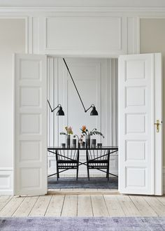 The Handvark marble dining table was not only a design challenge; Marble is both heavy and delicate so it took many prototypes to create the perfect table. Swing Arm Wall Light, Interior Styling, Interior Design, Blue Velvet Dining Chairs, Shabby Home, Black And White Interior, The Way Home, White Doors, Scandinavian Home