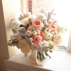 Gorgeous pink-and-white bouquet with garden roses, ranunculi, and lamb's ear