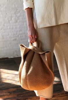 Slouchy bowl bag from Lauren Manoogian. Soft circular construction with side sli. Slouchy bowl bag from Lauren Manoogian. Soft circular construction with side slit handles. Raffia like texture. Crochet Bowl, Hand Crochet, Sacs Tote Bags, Reusable Tote Bags, Crochet Handles, Paper Bowls, Summer Bags, Luxury Handbags, Crochet Clothes