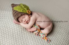 Fall is here!! This sweet bonnet is crocheted in a soft brown yarn and made complete with two large bright green leaves sewn onto the side. The wood