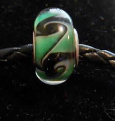 High Quality Green and Black Glass Bead on Etsy, $1.50