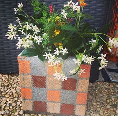 DIY Cinder Block Vase - Easy Inexpensive Crafts - Country Living - One crafty DIYer shows us how to take advantage of a cinder block's hollow design to create a whimsical—and cheap—garden container for the patio or yard.