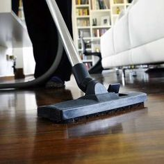 Vacuum hardwood floors to grab dust that's hiding between floorboards