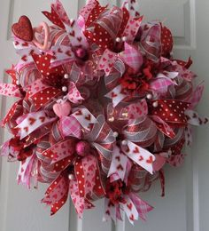 Hey, I found this really awesome Etsy listing at https://www.etsy.com/listing/177054017/pretty-in-pink-and-red-valentine-wreath