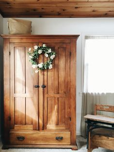 Rustic armoire + wreath + wood ceiling = farmhouse love <3
