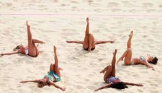 Cheerleaders perform during Women's Beach Volleyball match between China and Russia on Day 1 of the London 2012 Olympic Games at Horse Guards Parade on July 28, 2012 in London, England.